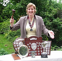 Hilary Davis with trophies won by Sans Souci Speakers Club